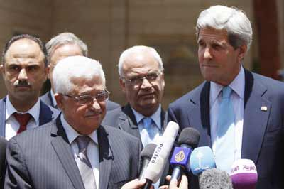 Secretary of State Kerry and Palestinian Authority President Mahmoud Abbas at a press conference following their meeting in Ramallah on June 30.