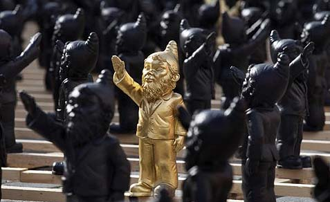German artist Ottmar Hörl's Poisoned Gnome uses the Nazi salute as part of an imagined set of toy action figures.