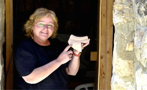 Hebrew University of Jerusalem archaeologist Dr. Eilat Mazar displays a jar fragment unearthed near the Temple Mount, bearing an inscription in the Canaanite language. Dated to the tenth century BCE.