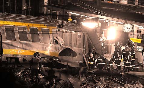 Rescue workers surrounded a derailed train after a crash on Friday in Bretigny-sur-Orge, France.