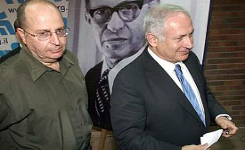 Defense Minister Moshe Ya'alon (L) with Prime Minister Benjamin Netanyahu against the background image of a former Likud premier.