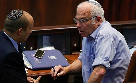 The men who know nothing: the State Attorney has told the high court that these two leaders of the Jewish Home party, Naftali Bennett (L) and Uri Ariel, along with the rest of the National Religious coalition members are being kept in the dark intentionally regarding the peace process in general and the prisoner releases in particular.