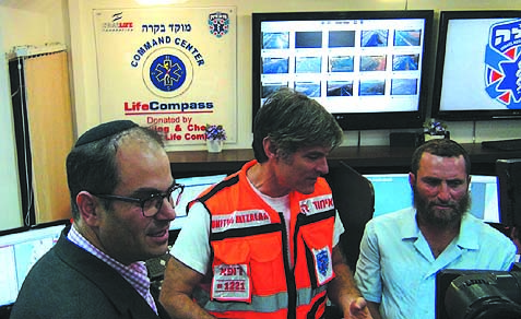 Popular physician and media personality Dr. Mehmet Oz is flanked by bestselling author Rabbi Shmuley Boteach and United Hatzalah of Israel founder Eli Beer during a visit to United Hatzalah's Jerusalem headquarters. Dr. Oz and his family are visiting Israel this week accompanied by Rabbi Boteach on a trip facilitated by philanthropists Dr. Miriam and Sheldon Adelson.