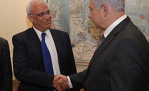 Prime Minister Benjamin Netanyahu (R) shaking hands with Palestinian negotiator Saeb Erekat in Jerusalem. Democratic Whip Steny Hoyer says Erekat now supports a unified Jerusalem.