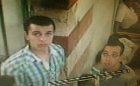 The two vandals, as recorded on CCTV.