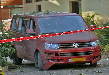 The missile attack shattered the windows and punctured tires of this van, which was parked without anyone inside at the time of the explosion. Photo by Shay Vakni/Tazpit News Agency