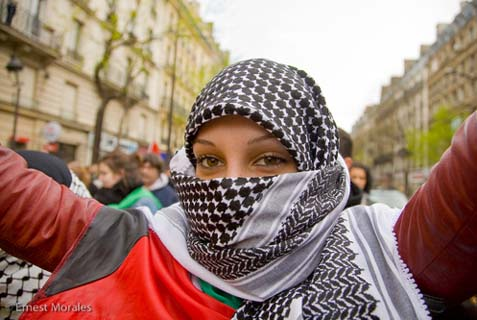 A woman in a headscarf and full-face covering at a demonstration in Paris, March 29, 2008.