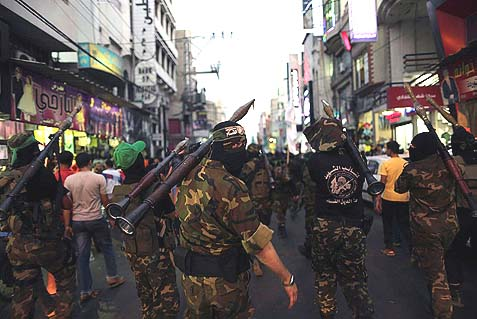 Masked members of the Ezz Al-Din Al Qassam militia, the military wing of Hamas marching in Gaza City.