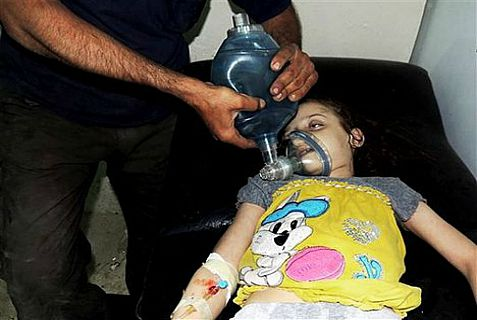 Girl being treated at a field hospital in Arbeen, Syria after chemical weapons attack.