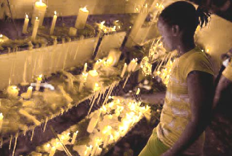 Kenyan girl lights a candle for victims of the Westgate mall massacre