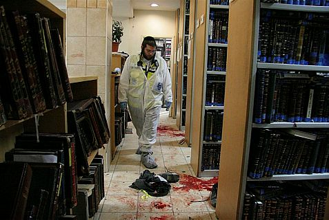Zaka rescue worker walks in bloodstained  Mercaz haRav Yeshiva  library after an Arab terrorist murdered students in March 2008.