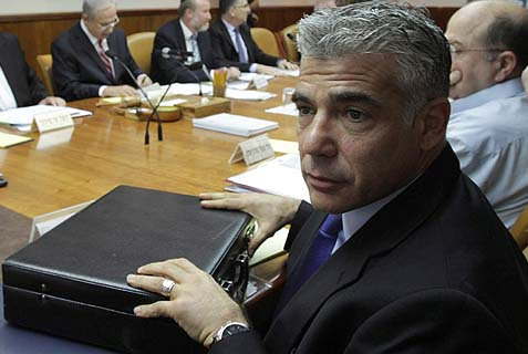 Finance Minister Yair Lapid with his briefcase at the weekly cabinet. The political star Lapid's shimmer is growing dim, as Israelis' disappointment of him is off the charts.