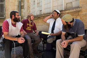 Hanenu Attorney Itamar Ben Gvir (white yarmulke) with clients (not in current case). Photo credit: Yonatan Sindel/Flash90.