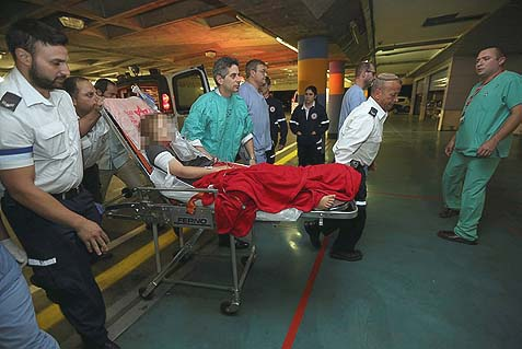 A 9-year old Jewish girl who was shot by a Palestinian sniper in Psagot is being wheeled into Shaare Tzedek hospital in Jerusalem, Saturday, October 5, 2013.