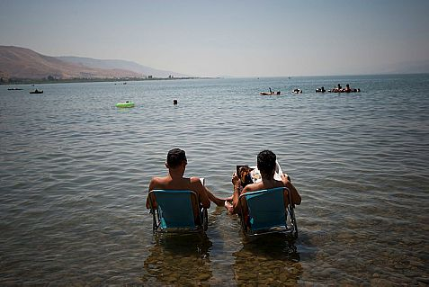 The official weather forecast is for average rainfall, which might allow the dam at the Kinneret to be opened to prevent flooding. Above: Relaxing on the Kinneret.