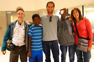 Feleke, Host Mom and JDC Volunteer Steve Weinberg at the airport in Detroit
