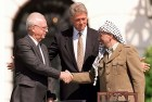 Rabin and Clinton swallow the lie and shake hands with Arafat.