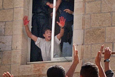 October, 2000, Ramallah Lynching: Palestinian mob killed and mutilated the bodies of two IDF reservists who mistakenly entered Ramallah.  The terrorist pictured was set free by Israeli gov'tin terrorist release.