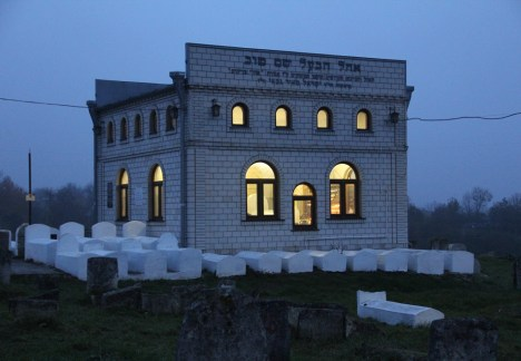 In the town of Medzhybizh is the tomb of the Baal Shem Tov - Rabbi Yisroel (Israel) ben Eliezer (18 Elul 5458/1698- 6 Sivan 5520/1760). The Baal Shem Tov or Besht, is the founder of the Hasidic movement in Judaism which stresses, among other things, a personal relationship with the Almighty, joy, and the importance of the Tzadick, that is, the righteous Rabbi who leads his flock. The building housing the tomb encompasses many of the Besht's top students and is considered by Hassidim as if it is actually a part of the land of Israel.