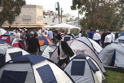 A tent city is erected for the overflow of visitors who couldn't find indoor lodging.