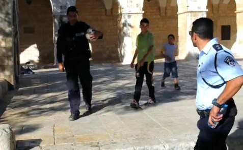 Police confiscate a soccer ball, after Arab children ignore the order to stop playing soccer on the Temple Mount.