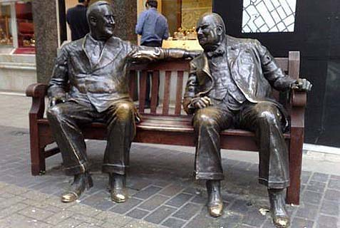 Franklin D. Roosevelt and Winston Churchill bronze statues, sitting on a bench in Mayfair, London.