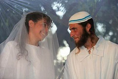 Newlywed couple Harel and Talya David under the Chupa in Karnei Shomron in Judea and Samaria.