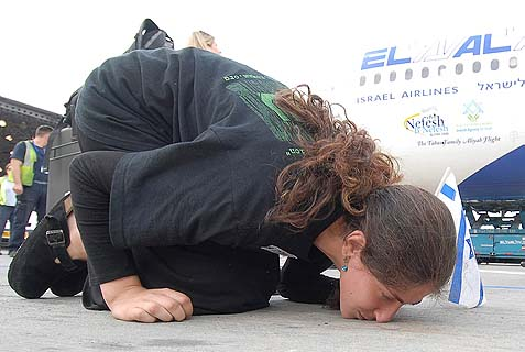 A Jewish olah kissing the ground on her first moment back in the home of her people. This is the essence of Isaiah 53 – a prophetic poem of the national redemption of God's children while the nations of the world are watching enviously.