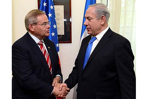 "Prime Minister Benjamin Netanyahu (R) shaking hands with Senate Foreign Relations Chair Robert ""Bob"" Menendez (D-NJ) during their meeting in Jerusalem, May 29, 2013."