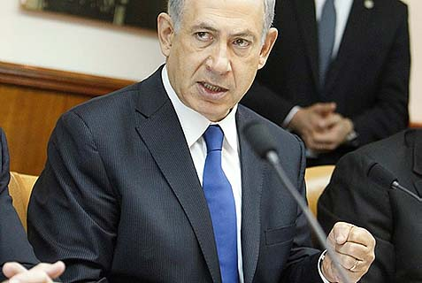 Prime Minister Benjamin Netanyahu speaking at the weekly cabinet meeting Sunday. There appear to be a wide gap between the PLO and Israel's notion of the agreements that were struck to facilitate the current peace talks.