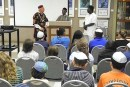 Left to right: Rabbi Wayne Franklin, Elder Ovadiah Agbai, and Elder Pinchas Ogbukaa speaking to students at Temple Emanu-El's Religious School.