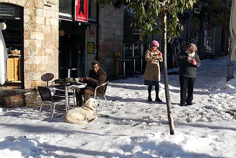 How civilized! Man having his morning coffee in a sidewalk cafe in Jerusalem.