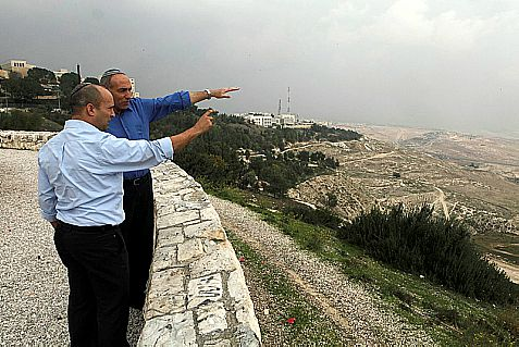"Naftali Bennett, chairman of the Jewish Home party, and Knesset Member Moti Yogev looking at ""E-1"" area of Maaleh Adumim."