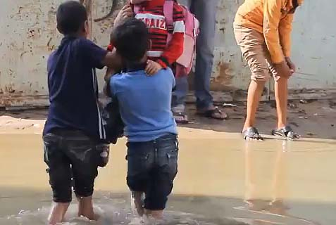 Gaza children wade in raw sewage in December 2013 -- well before the start of Operation Protective Edge and while construction supplies were being shipped into the region. Hamas was not taking care of its civilians; it was too busy building its terrorist infrastructure to attack Israel.