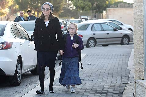 Eight-year-old Na'ama Margalese walking with her mother on her way to school in Beit Shemesh. Dec 29, 2011.