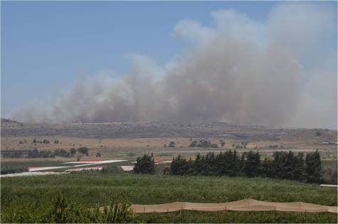 Gunfire in Syria seen from Israel on the Golan Heights border.