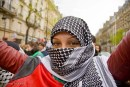 A woman in a headscarf and full-face covering at a demonstration in Paris.