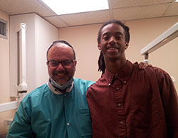 Dr. Canter with his dental assistant's nephew Nathaniel Hagans.