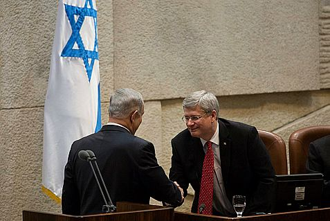Canada's Prime Minister Stephen Harper shakes hands with Prime Minister Netanyahu at the Knesset Monday.
