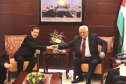 "Labor Chairman Yitzhak ""Buji"" Herzog (L) meeting with PA Chairman Mahmoud Abbas in the the Muqata in Ramallah. Herzog's ally in the party, MK Eitan Cabel, told Israel Radio neither the PLO nor Israel have been negotiating in good faith."