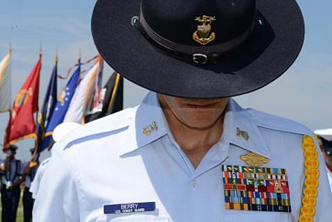 See no evil, stop no evil. A Coast Guard member bowing his head. This may become the new preferred approach of U.S. border officers regarding who gets in despite a terrorism record.