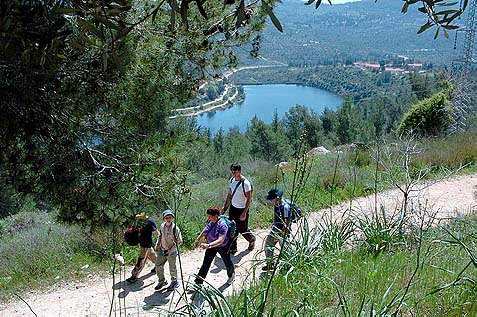 A hiking path through the Judean mountains and valleys, with the Beit Zait lake in the background.
