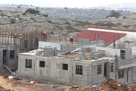 New construction in the Samaria town of Ariel, January 17, 2014. The amazing growth rates in Judea and Samaria communities have been achieved despite delays and freezes in construction bids and land-use planning.