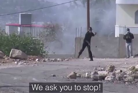 Palestinian Authority rock-throwing terrorists in action as soldiers ask them to please stop.
