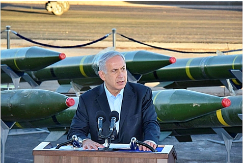 Israeli Prime Minister Binyamin Netanyahu with missiles being sent from Iran to Gaza on a ship which the IDF diverted. March 10, 2014.