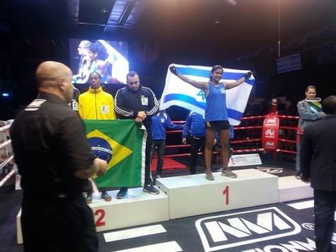 Sarah Avraham wining the women's Thai boxing championship.
