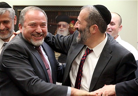 Avigdor Liberman (L) and Aryeh Deri (R) in happier days.