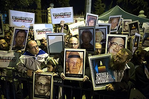 "Israelis hold up photos of friends and loved ones, who were murdered by terrorists the Israeli government is releasing, in exchange for Abu Mazen not cancelling  the ""peace talks""."