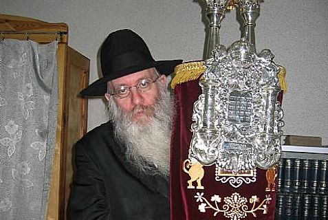 Rabbi Yitzchok Meyer Lipszyc, a Chabad-Lubavitch emissary in Crimea for more than two decades, with a Torah scroll.