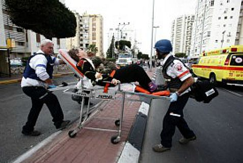 Israeli medics treat a woman injured by a grad missile from Gaza.